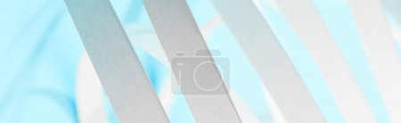 Photo for Close up view of white paper stripes on blue background, panoramic shot - Royalty Free Image
