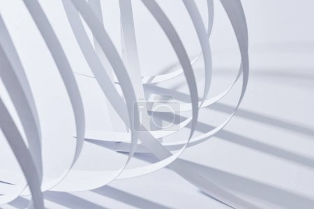 close up view of curved paper stripes on white background
