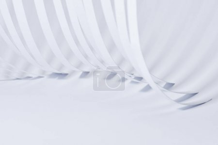 Photo for Close up view of curved paper stripes on white background - Royalty Free Image