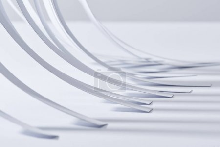 Photo for Close up view of curved paper stripes on white surface - Royalty Free Image