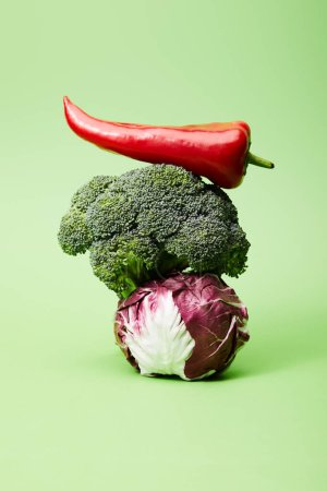 Photo for Chili pepper, broccoli and red chinese cabbage on green - Royalty Free Image