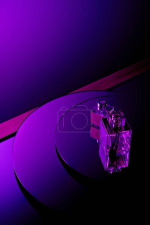 Photo for Purple perfume bottles on round mirror surface with dark violet background - Royalty Free Image