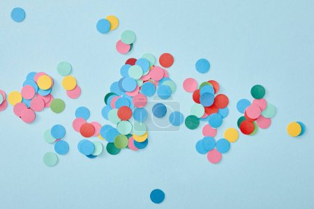 Photo for Top view of colorful round confetti on blue background - Royalty Free Image