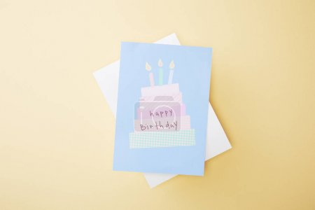 Photo for Top view of festive happy birthday greeting card on beige background - Royalty Free Image
