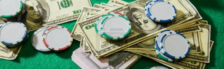 Photo for High angle view of dollar banknotes and casino chips on green background, panoramic shot - Royalty Free Image