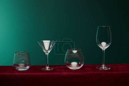 Photo for Liqueur glass, cocktail glass, brandy glass and wine glass isolated on green - Royalty Free Image