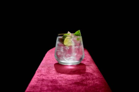 Photo for Old fashioned glass with fresh cold mojito, mint and lime slice isolated on black - Royalty Free Image