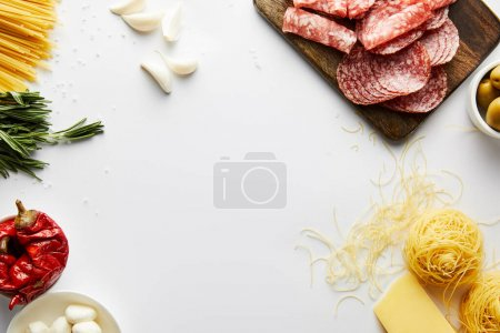 Photo for Top view of meat platter, pasta and ingredients on white background - Royalty Free Image