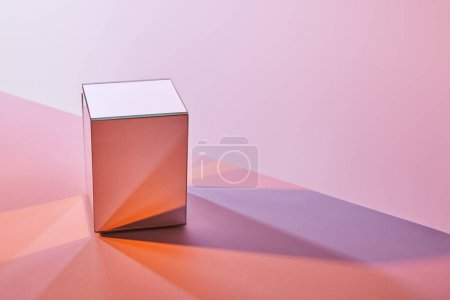 cube with light reflection on surface on violet and pink background