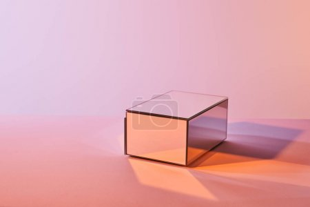 Photo for Cube with light reflection on surface on violet and pink background - Royalty Free Image