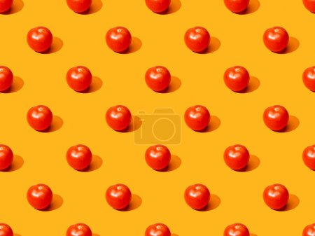 Photo for Fresh tomatoes on orange colorful background, seamless pattern - Royalty Free Image