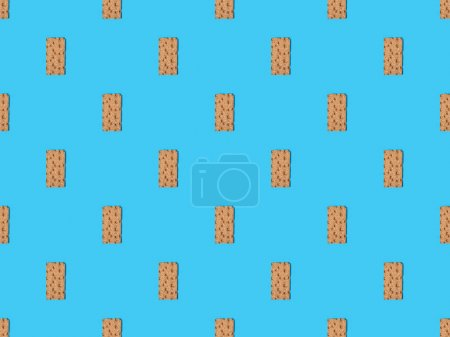 top view of fresh crispbread on blue colorful background, seamless pattern