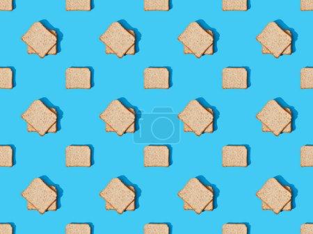 Photo pour Vue du dessus du pain grillé frais sur fond bleu coloré, motif sans couture - image libre de droit