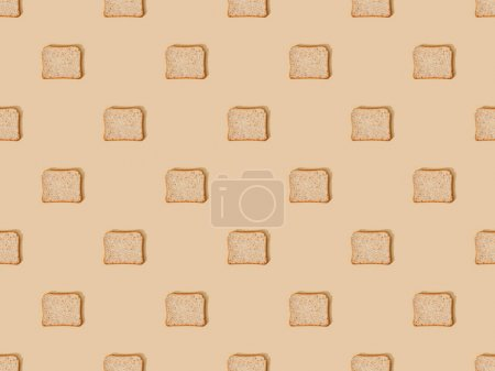 Photo for Top view of fresh toast bread on beige background, seamless pattern - Royalty Free Image