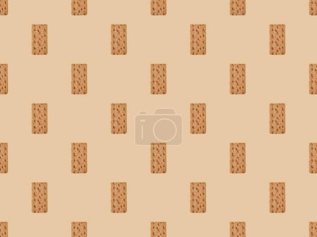 Foto de Vista superior del pan crujiente fresco sobre fondo beige, patrón sin costuras. - Imagen libre de derechos