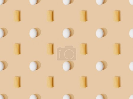 Photo for Top view of fresh cannelloni with eggs on beige background, seamless pattern - Royalty Free Image