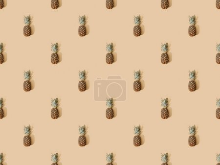Photo for Top view of whole ripe pineapples on beige background, seamless pattern - Royalty Free Image