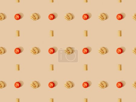 Photo for Top view of fresh pasta with tomatoes on beige background, seamless pattern - Royalty Free Image