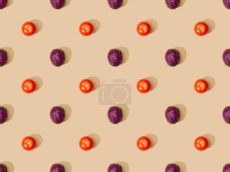 top view of whole ripe red cabbage and tomatoes on beige background, seamless pattern