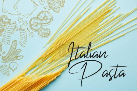 Photo for Top view of raw spaghetti on blue background with Italian pasta illustration - Royalty Free Image