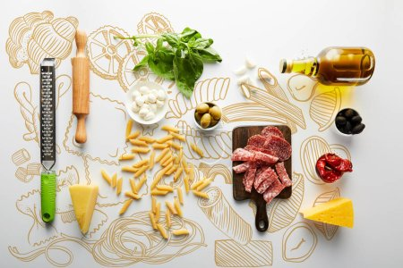 Photo for Flat lay with meat platter, bottle of olive oil, rolling pin, grater and ingredients on white background, food illustration - Royalty Free Image