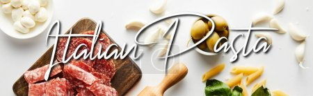 Photo for Panoramic orientation of meat platter, rolling pin, pasta, garlic and bowls with olives and mozzarella on white background, italian pasta illustration - Royalty Free Image