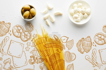 Photo for Top view of spaghetti, garlic, sea salt and bowls with olives and mozzarella on white background, food illustration - Royalty Free Image