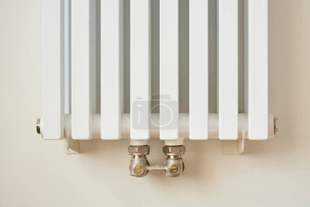 Photo for White and modern heating radiator near wall in apartment - Royalty Free Image