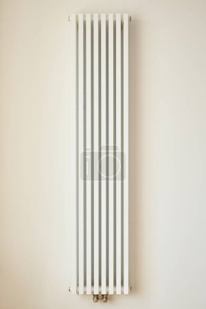 Photo for White heating radiator near wall in apartment - Royalty Free Image