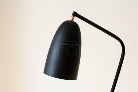 Photo for Black and modern lamp near white wall - Royalty Free Image