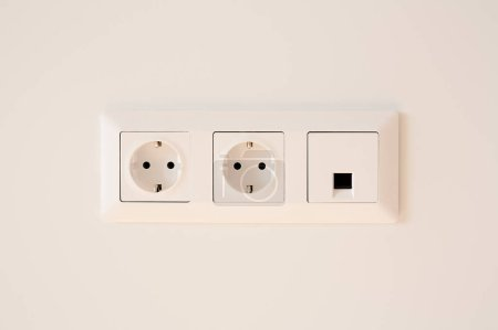 switch near power plugs on white