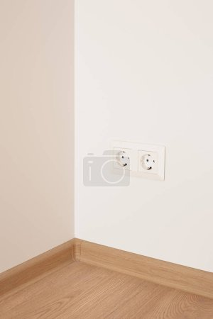 Photo for Modern power sockets on wall in apartment - Royalty Free Image