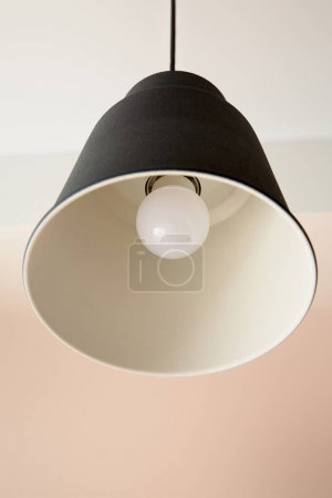Photo for Low angle view of modern lamp with light bulb - Royalty Free Image