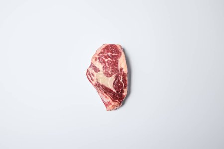 Photo for Top view of fresh raw steak on on white background - Royalty Free Image