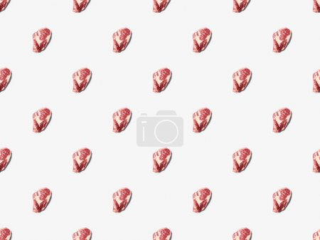 Photo for Top view of fresh raw steak on on white background, seamless background pattern - Royalty Free Image