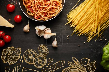 Photo for Top view of tasty bolognese pasta in frying pan on black background with fresh ingredients, food illustration - Royalty Free Image