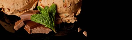 Photo for Close up view of fresh delicious chocolate ice cream with mint leaves isolated on black, panoramic orientation - Royalty Free Image