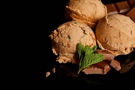 Photo for Fresh delicious chocolate ice cream with mint leaves isolated on black - Royalty Free Image