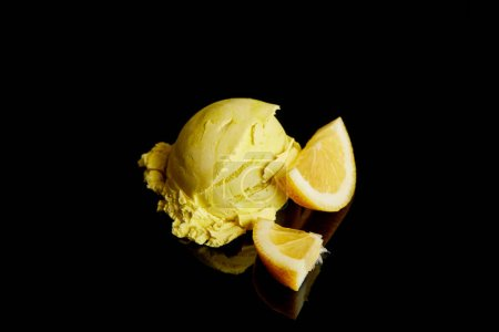 Photo for Fresh delicious lemon ice cream isolated on black - Royalty Free Image
