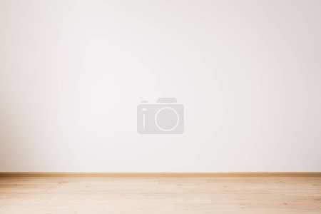Photo for Grey empty wall and wooden beige floor - Royalty Free Image