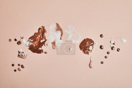Photo for Top view of melted brown and white ice cream on pink background - Royalty Free Image