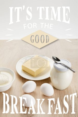 Photo for Delicious organic dairy products and eggs on wooden table isolated on white, it is time for good breakfast illustration - Royalty Free Image