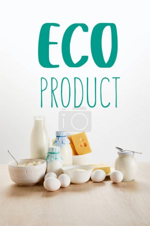Photo for Delicious organic dairy products and eggs on wooden table isolated on white with eco product illustration - Royalty Free Image