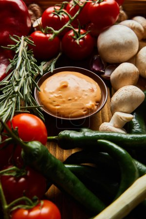 delicious sauce in bowl near fresh ripe vegetables