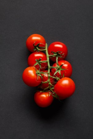 top view of ripe and fresh cherry tomatoes on black