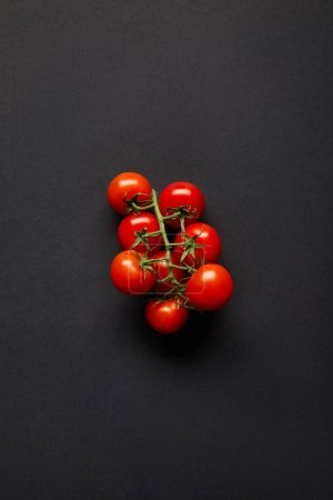 Photo for Top view of organic and fresh cherry tomatoes on black - Royalty Free Image
