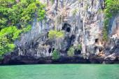 Island, Ocean views near Phuket Thailand with Blues, Turquoise and Greens oceans, mountains, boats, caves, trees resort island of phuket Thailand. Including Phi Phi, Ko Rang Yai, Ko Li Pe and other islands. Asia.