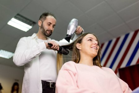 Young woman gets new hairstyle at the hairdresser. Beauty salon