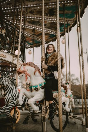 Young woman in the carousel of Paris