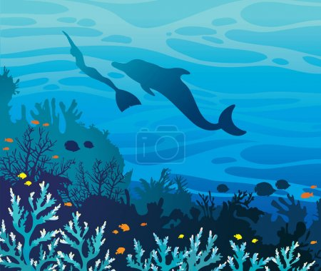 Dolphin and freediver. Coral reef and sea.